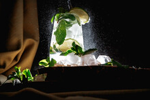 Mojito Cocktail On A Dark Background. Wooden Stand.
