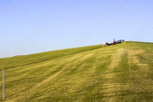 Obraz na plátne Man On Golf Course On Field Against Clear Sky