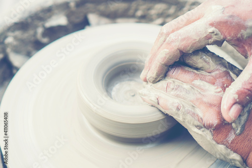 Cropped Hands Of Man Making Pot Outdoors Fototapet
