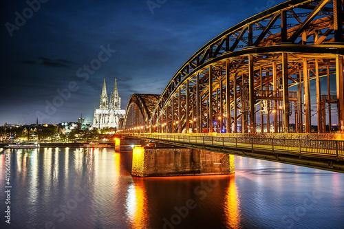 Obraz na plátne Bridge Over River In City At Night