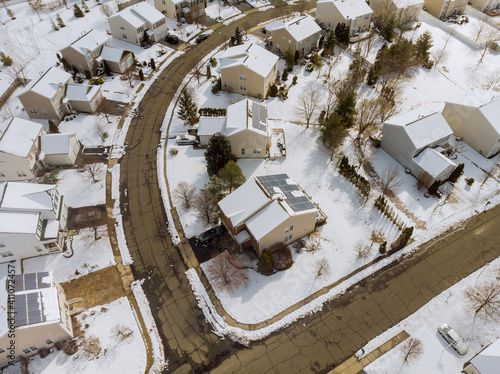 Fototapeta Aerial down view to on covered houses and roads at winter season courtyards cove
