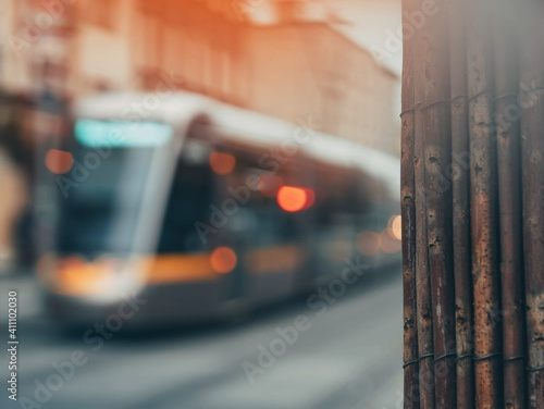 Fototapeta Close-up Of Wood With Cable Car Moving On Street In City obraz