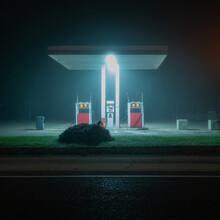 View Of Illuminated Gas Station At Night