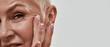 Leinwandbild Motiv Cute wrinkles around eyes on middle aged woman