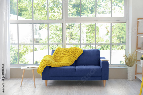 Fototapeta Interior of modern room with blue sofa near window obraz