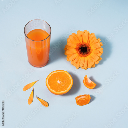 Orange colored summer items against blue background Tapéta, Fotótapéta