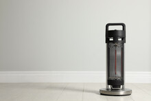 New Modern Electric Heater On Floor In Room, Space For Text