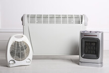 Three Different Electric Heaters On Floor In Room