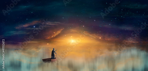 Cuadros en Lienzo Man in cowl, magician floating on ship in clouds at sunset sky with stars