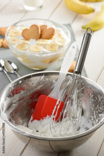 Fototapeta Metal bowl, whisk and silicone spatula after whipping cream