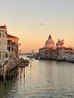 Venice, Italy - winter 2020: view on an empty Grand Canal and Basilica della Salute during sunset with seagull in the sky