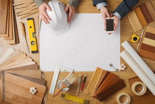 Obraz Businessman and construction engineer working at desk - fototapety do salonu