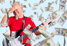 Senior Handsome Grey-haired Man Playing Electric Guitar Stressed And Frustrated With Hand On Head, Surprised And Angry Face