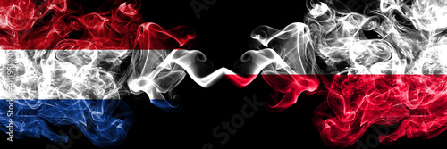 Netherlands vs Poland, Polish, Pole smoky mystic flags placed side by side. Thick colored silky abstract smoke flags.