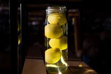 Big Jar Of Whole Canned Lemons On A Dark Background