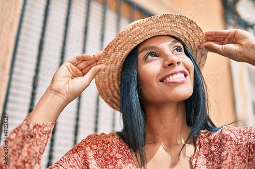 Obraz Young african american tourist woman on vacation smiling happy walking at the city. - fototapety do salonu