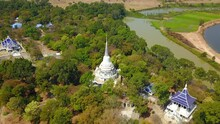 4K-Top View From Flying Drone Over Wat Phra Phut Tha Bat,temple And Pagoda  In Mahashanachai Town, Yasothon  Province,Thailand,ASIA.