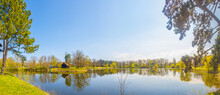 Panoramic View Over City Park And Lake In Spring Colors At Sunny Day With Blue Sky, Magdeburg, Germany.