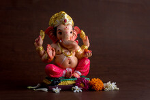 Close-up Of Ganesha Statue Against Colored Background