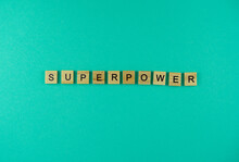 Word Superpower. The Phrase Is Laid Out In Wooden Letters. Top View. Motivation. Blue Background. Copy Space