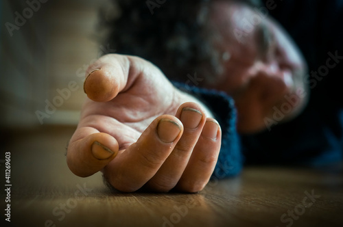 Valokuvatapetti Close-up Of Dead Body Hand On Floor
