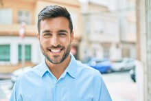 Young Hispanic Man Smiling Happy Standing At Street Of City.