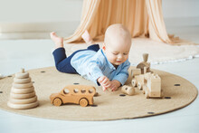 Baby Playing With Wooden Toys. Eco-friendly Wooden Toys For Children