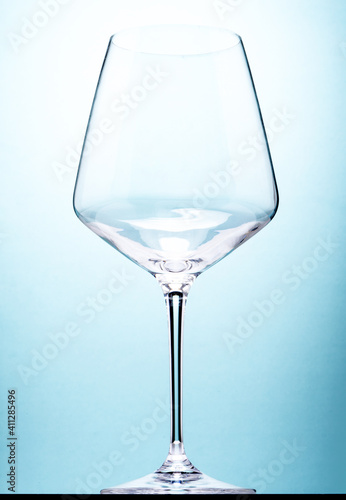 Fototapeta Close-up Of Wine Glass On Table Against Turquoise Background obraz