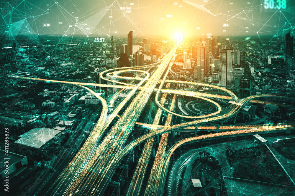Fototapeta Futuristic road transportation technology with digital data transfer graphic showing concept of traffic big data analytic and internet of things .