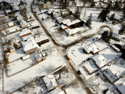 Fotomural Aerial drone view of roads and houses winter landscape