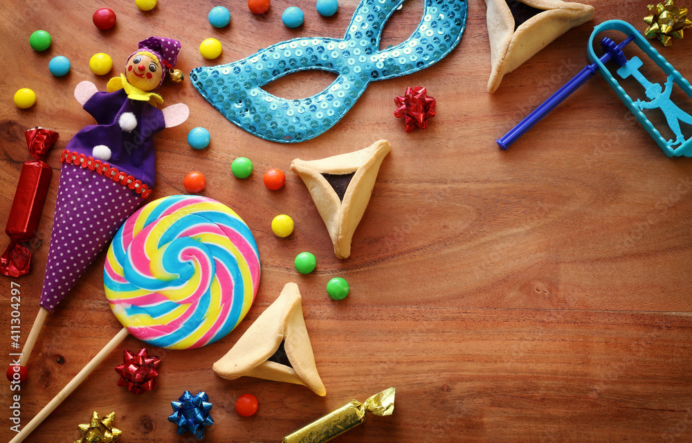 Fototapeta Purim celebration concept (jewish carnival holiday) over wooden background. Top view, flat lay