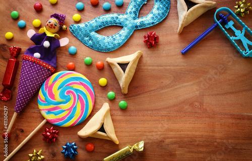 Obraz na plátně Purim celebration concept (jewish carnival holiday) over wooden background