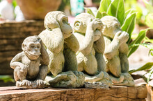 Three Wise Monkeys And A Fourth Monkey Scratching His Head In Wat Umong