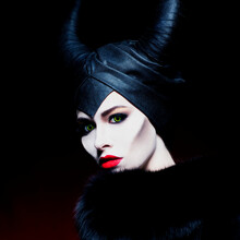 Beautiful Girl With Horns On Black Background