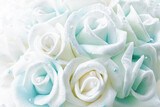 blurry white blue yellow roses