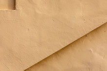 Horizontal Close-up Image Of A Beige Stucco Wall, With A Small Indentation At Top Left And A Triangular Indent At Lower Right, A Useful Image For Copy Space.