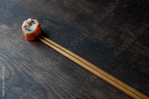 Fototapeta maki on gray plate and wooden table obraz
