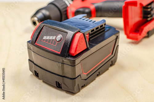 Wallpaper Mural Electric drill or cordless screwdriver with battery, recharge battery