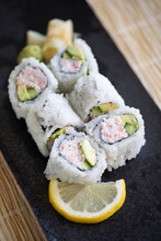 Close-up Of Japanese California Roll On A Black Plate