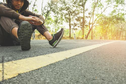 Obraz Full Length Of Man Sitting On Road - fototapety do salonu