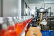 Inside of beverage industry automatic machine with product line of red juice