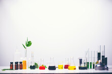 Colorful Chemicals In Laboratory Glassware Against White Background