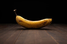 Image Of Ripe Yellow Banana Close Up On Rustic Wooden Surface And Black Background