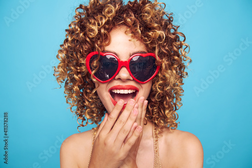 Fotografie, Obraz Emotional woman covered her mouth with her hand red lips