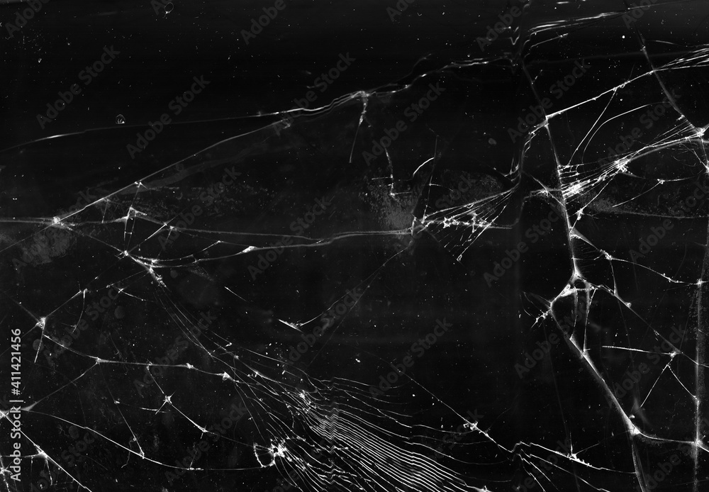 Fototapeta Fractured background. Broken glass texture. Black shattered aged faded window with dust scratches smeared stains abstract wallpaper.