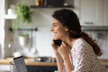 Close Up Of Smiling Millennial Caucasian Woman Have Pleasant Cellphone Call At Home Office. Happy Young Female Talk Speak On Smartphone, Chat On Gadget Using Mobile Provider Connection.