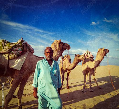 Obraz na plátně Cameleer (camel driver) with camels in dunes of Thar desert. Raj