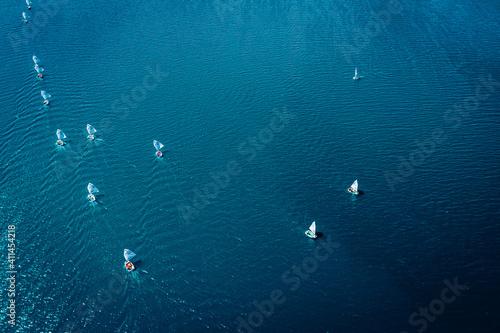 Fotografie, Obraz Regatta of small boats on blue lake, aerial view