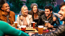 Happy Friends Drinking Beer At Brewery Bar Dehor - Friendship Lifestyle Concept With Young Milenial People Enjoying Time Together At Open Air Pub - Warm Color Tones On Vivid Filter With Focus On Girls
