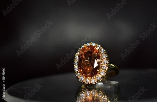 Fototapeta Gold ring decorated with yellow gemstone obraz
